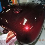 "Fire Red Motorcycle tank sprayed with our .004"" Fire Red Flake."