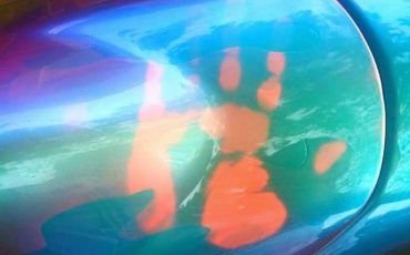 John Haro's handprint on his thermochromic pigment painted motorcycle tank. Temperature changing chameleon!.