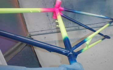 Several Neon Glow Pigments on a bike frame